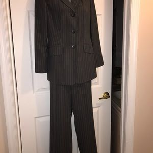 Grey pinstriped two piece suit size 8 Petite